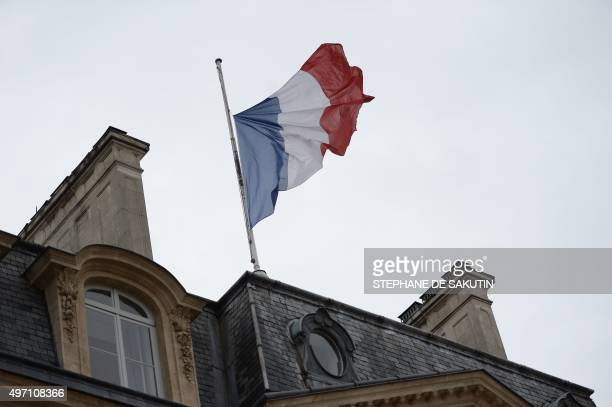 The French flag at half mast is seen at the Elysee palace in Paris on November 14 following a series of coordinated attacks in and around Paris late...