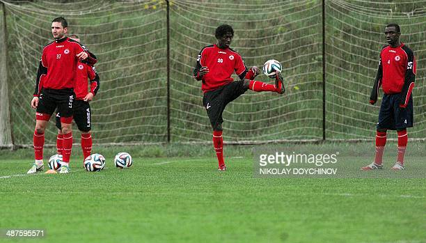 The French football player of the CSKA Sofia Jeremy FaugPorret attends a team's training session with his French teammate Omar Kossoko and Stephen...
