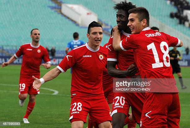 The French football player of the CSKA Sofia Omar Kossoko celebrates with teammates after scoring against Levski Sofia during their Bulgarian...