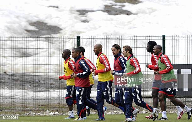 The French football team runs during a training session in preparation for the upcoming Euro 2008 May 24 2008 in Tignes French Alps France has been...