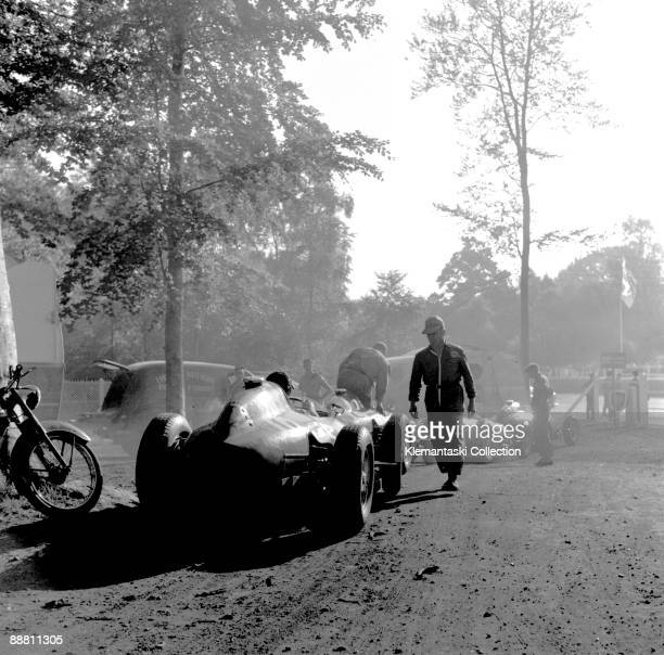 The French Grand Prix Rouenles Essarts July 7 1957 Early morning in the Rouen paddock which was in a lovely grove of pines � the Ferraris are in line...