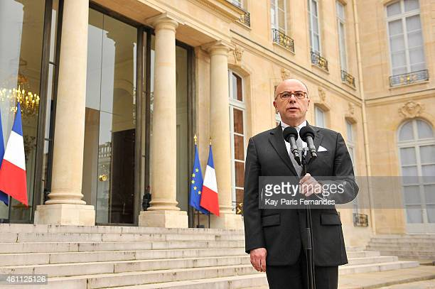 The French Interior Minister Bernard Cazeneuve speaks to the press after a crisis meeting with French President Francois Hollande at the Elysee...