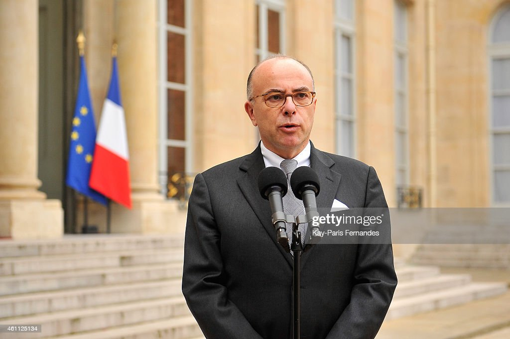 The French Interior Minister <a gi-track='captionPersonalityLinkClicked' href=/galleries/search?phrase=Bernard+Cazeneuve&family=editorial&specificpeople=4205153 ng-click='$event.stopPropagation()'>Bernard Cazeneuve</a> speaks to the press after a crisis meeting with French President Francois Hollande at the Elysee Palace following the attack on satirical magazine Charlie Hebdo on January 7, 2015 in Paris, France. Twelve people were killed including two police officers as two gunmen opened fire at the magazine offices.