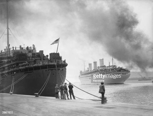 The French liner Ile de France currently serving as a World War II troopship pulls into Southampton for the first time and passes the captured German...