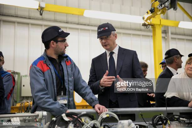 FORET VALENCIENNES FRANCE SEPTEMBER 29 The French Minister of Economy is photographed for Paris Match with some workers of Alstom firm at PetitForet...
