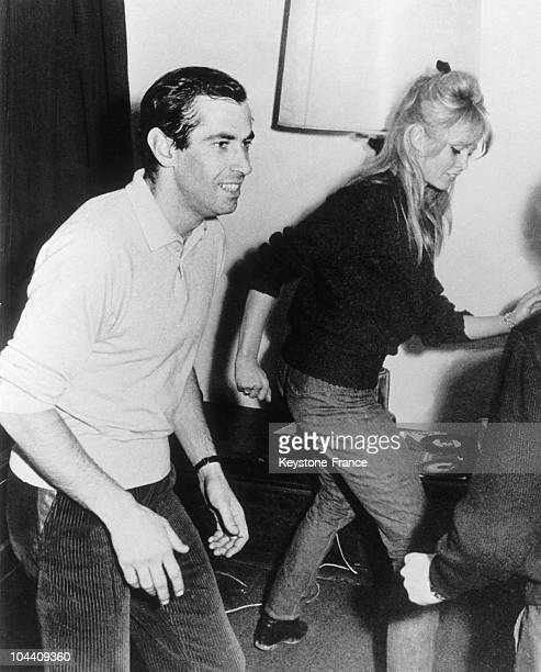 The French movie director Roger VADIM and his wife Brigitte BARDOT doing the twist in a villa in Florence