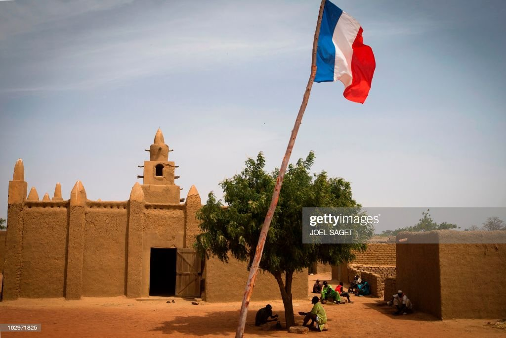The French national flag flies outside Bore's mosque, near Mopti, on March 2, 2013. French and Malian troops have been pushing back armed Islamist militant groups for nearly two months, after they gained control of the north of the country during 2012. AFP PHOTO /JOEL SAGET