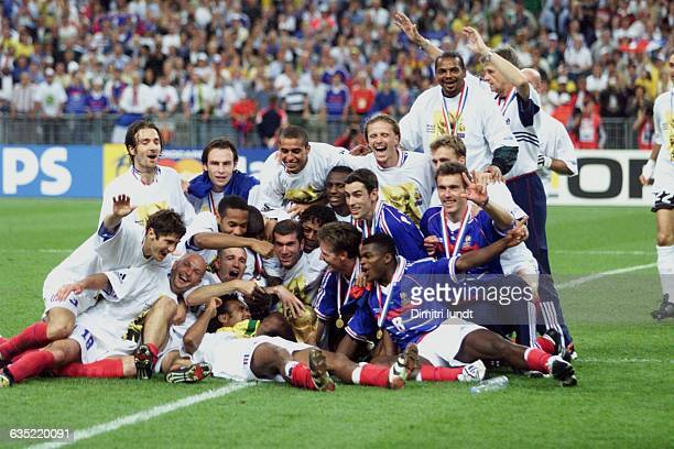 The French national team poses for a team portrait after their victory in the 1998 World Cup finals over Brazil