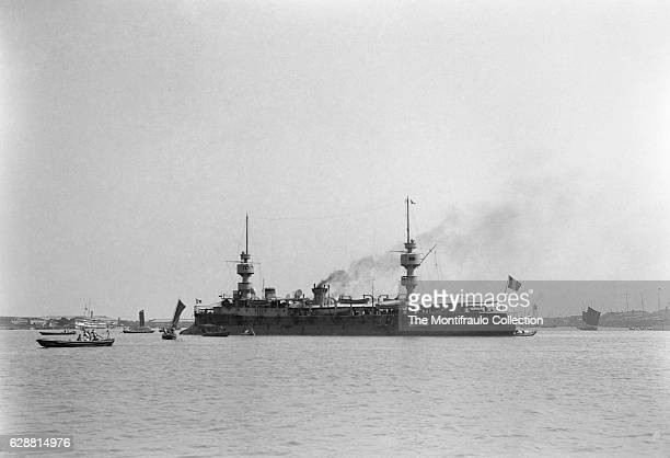 The French Navy armored cruiser Amiral Charner built by Arsenal de Rochefo anchored off a busy Shanghai harbour in China during the Boxer Rebellion...