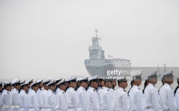 The French navy command ship Dixmude is welcomed by Chinese soldiers upon its arrival at the Wusong naval port of Shanghai on May 9 2015 The LHD...