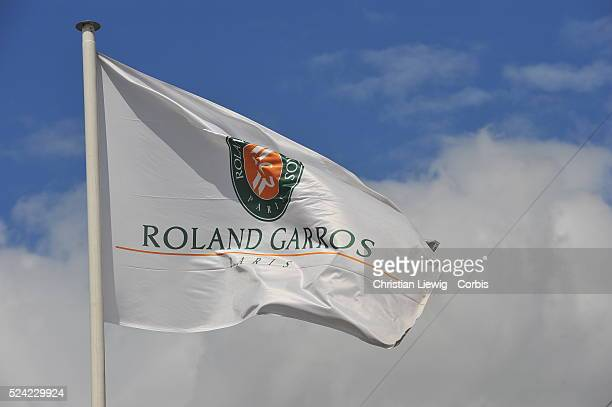 The French Open at Roland Garros flag flies with the bue sky in the background
