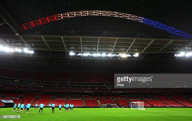 The French players run through their drills under the Wembley arch lit up in the colours of the French Tricolore during the France training session...