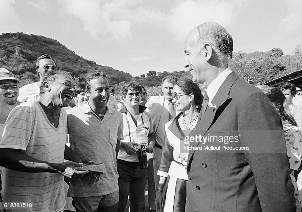 The French Presidential couple Valery Giscard d'Estaing and his wife AnneAymone d'Estaing share a joke with Guyaneseborn Guadeloupean singer Henri...