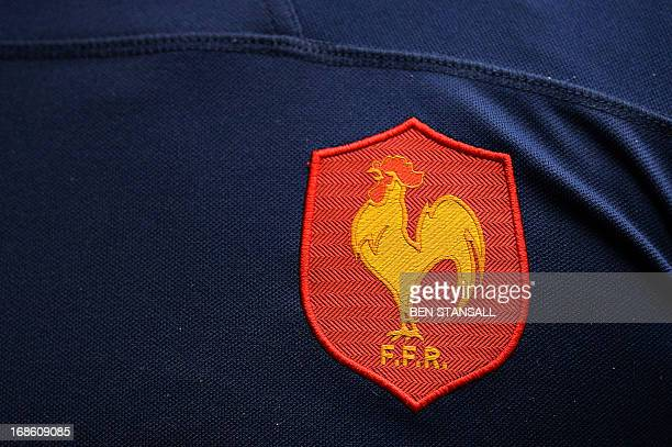 The French rugby union crest is seen on the shirt of France's Vincent Deniau as he leaves the pitch following the Rugby Union England Sevens Bowl...