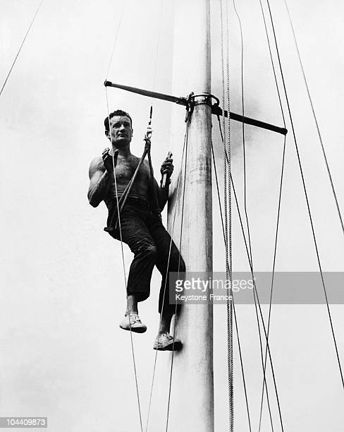 The French sailor Eric TABARLY repairing the mast of his trimaran the PEN DUICK IV in Cornouailles little harbour Eric TABARLY had to give up the...