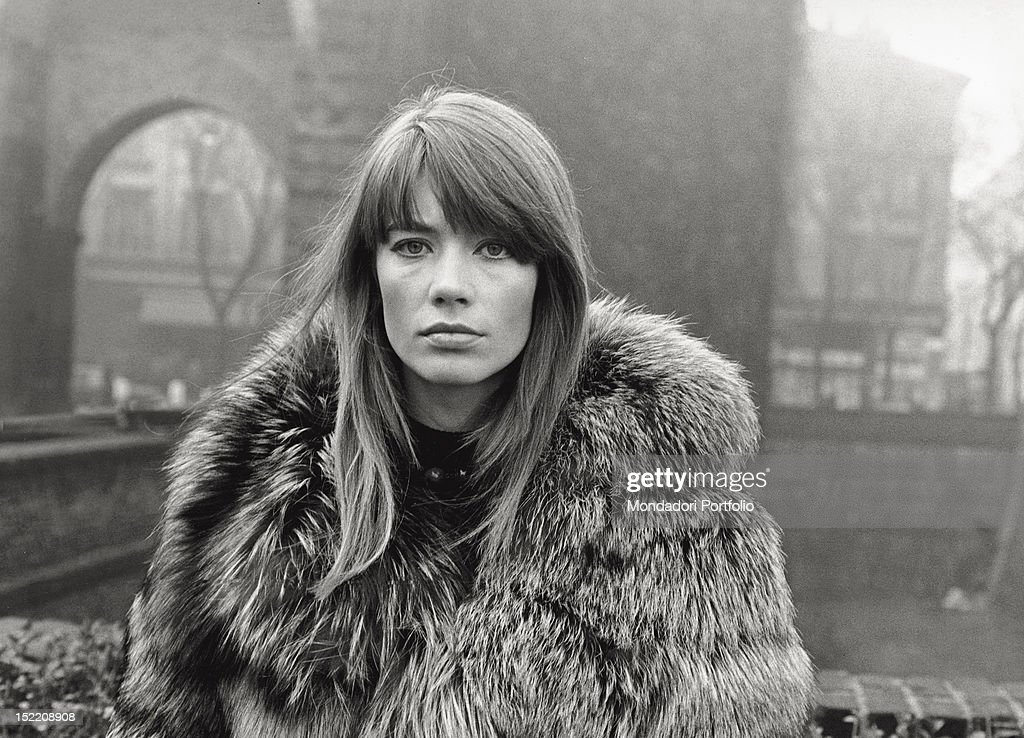 The French singer and actress <a gi-track='captionPersonalityLinkClicked' href=/galleries/search?phrase=Francoise+Hardy&family=editorial&specificpeople=941715 ng-click='$event.stopPropagation()'>Francoise Hardy</a> wearing a fur coat in Piazza Sant'Ambrogio. Milan, 1960s