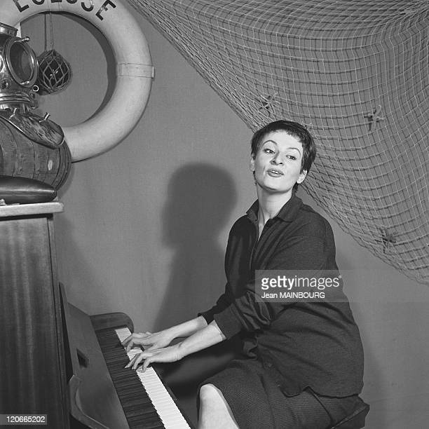 The French singer Barbara playing the piano in 1950s