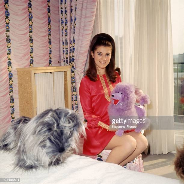 The French singer SHEILA posing in her bedroom in Paris with her stuffed dog in April 1967