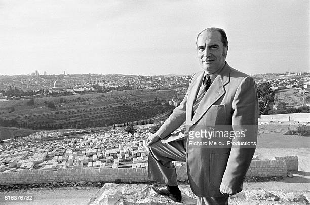 The French Socialist Party's first secretary Francois Mitterand stands on the Mount of Olives with the AlAqsa Mosque visible in the background...
