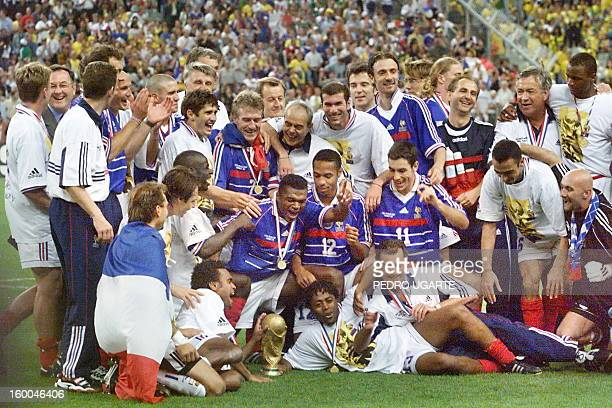 The French team celebrates with the FIFA trophy 12 July at the Stade de France in SaintDenis after France defeated Brazil 30 in the 1998 World Cup...
