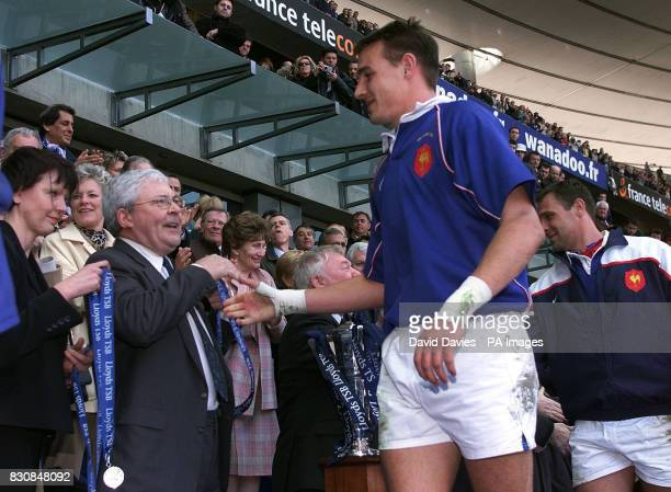 The French team collect their medals after a 445 win over Ireland to complete the Grand Slam and win the Lloyds TSB Six Nations Championship match at...