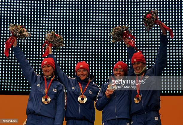 The French team of Delphyne Peretto Florence BaverelRobert Sylvie Becaert and Sandrine Bailly celebrate recieving the Bronze Medal in the Womens...