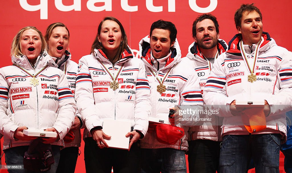 The French team of <a gi-track='captionPersonalityLinkClicked' href=/galleries/search?phrase=Tessa+Worley&family=editorial&specificpeople=855344 ng-click='$event.stopPropagation()'>Tessa Worley</a>, Anemone Marmottan, Taina Barioz, Thomas Fanara, <a gi-track='captionPersonalityLinkClicked' href=/galleries/search?phrase=Gauthier+De+Tessieres&family=editorial&specificpeople=871413 ng-click='$event.stopPropagation()'>Gauthier De Tessieres</a> and Richard Cyprien celebrate at the medal ceremony after winning gold for their victory in the Nations Team Event during the Alpine FIS Ski World Championships on the Kandahar course on February 16, 2011 in Garmisch-Partenkirchen, Germany.