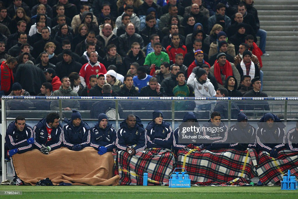 The French team substitutes bench keep warm on a bitterly cold night during the International Friendly match between France and Morocco at the Stade...