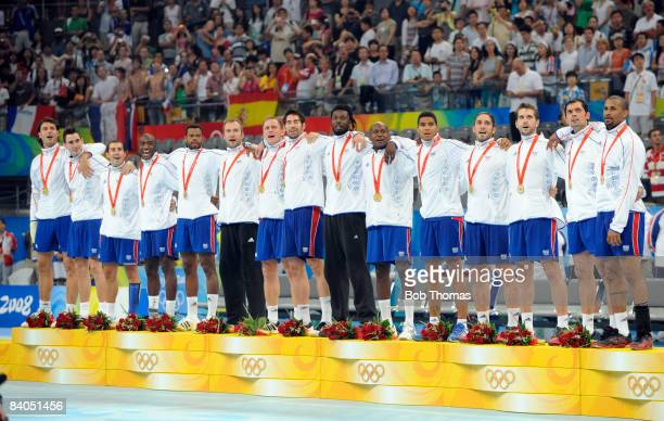 The French team with their Gold Medals stand on the podium following their victory in the Men's Handball Gold Medal Match between France and Iceland...