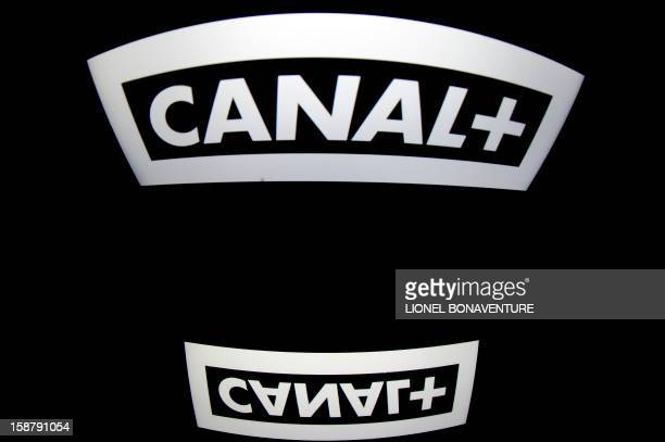 The French television channel 'Canal' logo is displayed on a tablet screen on December 29 2012 in Paris AFP PHOTO / LIONEL BONAVENTURE