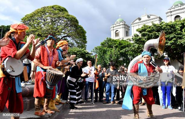 The French theater and music group 'La Tit Fanfare Cirkus' performs on the streets of San José on July 3 during their participation in the...