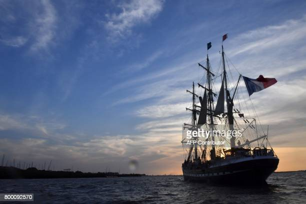 TOPSHOT The French threemasted barque 'Belem' leaves Nantes western France on June 22 2017 while taking part in the parade on the Loire river from...
