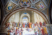 The fresco The School of Athens by Raphael on display in the Vatican Museums on August 4 in Rome Italy Vatican City a walled enclave within the city...