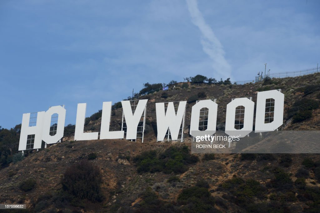 The freshly painted Hollywood sign is seen after a press conference to announce the completion of the famous landmark's major makeover on December 4, 2012 in Hollywood, California. Some 360 gallons (around 1,360 liters) of paint and primer were used to provide the iconic sign with its most extensive refurbishment in almost 35 years in advance of its 90th birthday next year. AFP PHOTO / Robyn Beck