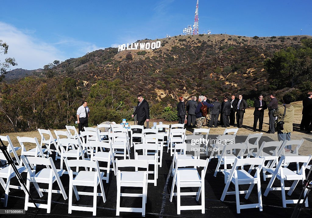 The freshly painted Hollywood sign is seen atop the Hollywood Hills following a press conference to announce the completion of the famous landmark's major makeover on December 4, 2012 in Hollywood, California. Some 360 gallons (around 1,360 liters) of paint and primer were used to provide the iconic sign with its most extensive refurbishment in almost 35 years in advance of its 90th birthday next year. AFP PHOTO / Robyn Beck