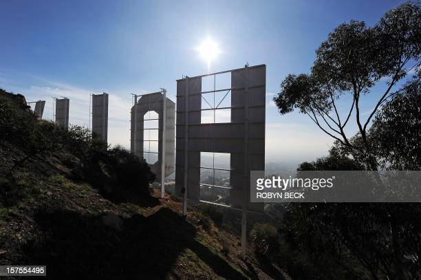 The freshly painted Hollywood Sign is unveiled after a press conference to announce the famous landmark's major makeover December 4 2012 in Hollywood...