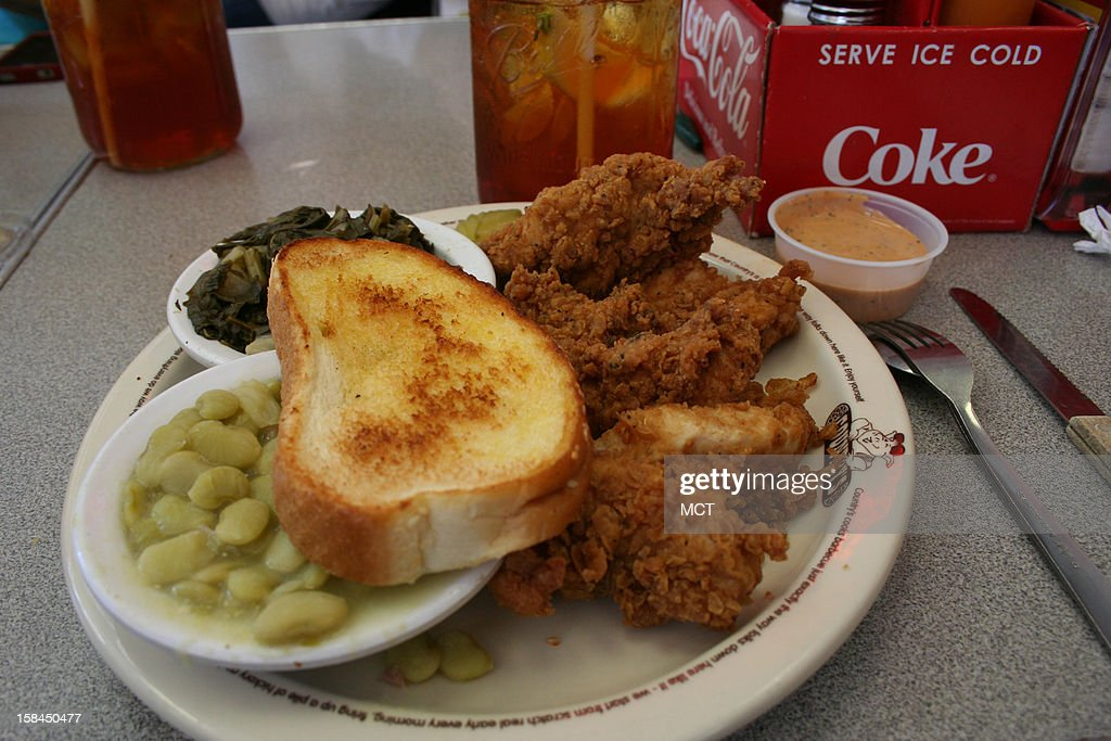 The fried chicken is piled high at Country's Barbecue in Columbus, Georgia. Southern cooking reigns here with specialties such as barbecue, ribs, and Brunswick Stew.