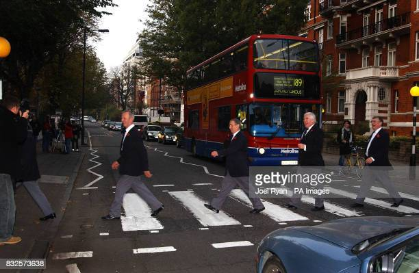 The Fron male choir from Wales cross Abbey Road near St John's Wood in London after members of the 60strong group made their musical pilgrimage to...