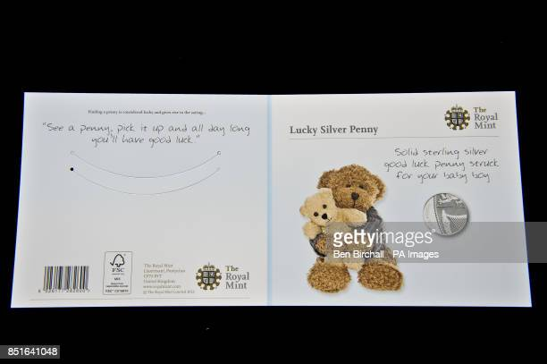 The front and back of the blue for baby boys Silver Penny card produced by the Royal Mint to coincide with the brith of the royal baby PRESS...