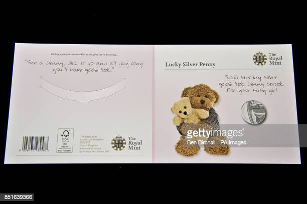 The front and back of the pink for baby girls Silver Penny card produced by the Royal Mint to coincide with the brith of the royal baby PRESS...