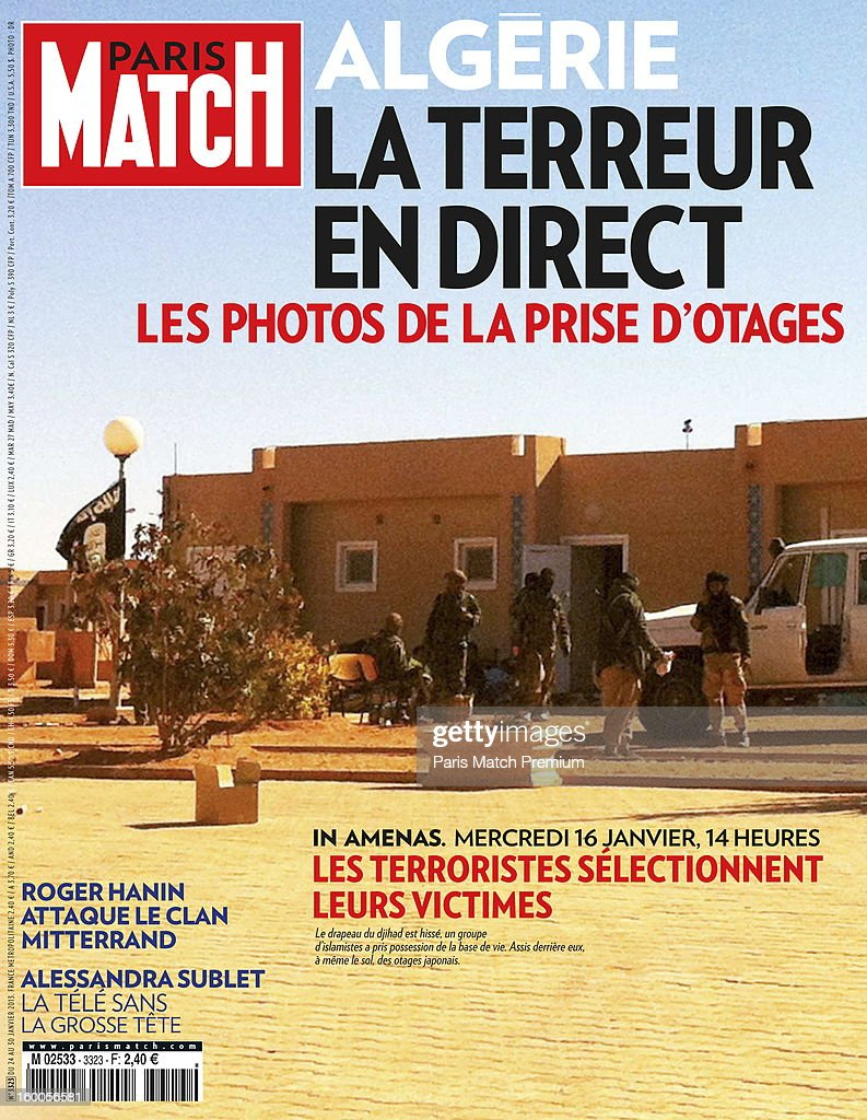 The front cover of Paris Match, displaying an image taken by an unnamed hostage with his mobile phone of Islamic jihadists who attacked the Algerian gas site of Tinguentourin on January 16, 2013 in Amenas, Algeria. Dozens of civilians and militants were killed during the four day siege undertaken by a group led by jihadist Mokhtar Belmokhtar.
