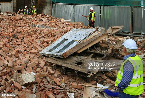 The front door lies on a pile of rubble after demolition work on Mick and Mairead Philpott's old family home on Victory Road Derby where the two...