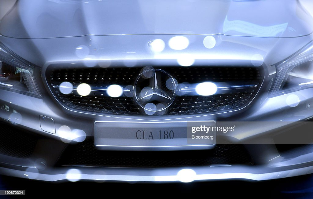The front grill of a Mercedes-Benz CLA 180 automobile is seen in this double exposure as the vehicle sits on display during the company's earnings news conference in Stuttgart, Germany, on Thursday, Feb. 7, 2013. Daimler AG, the world's third-largest maker of luxury vehicles, forecast unchanged 2013 profit as spending for new models and a revamp of the automaker's operations eat into earnings. Photographer: Guenter Schiffmann/Bloomberg via Getty Images