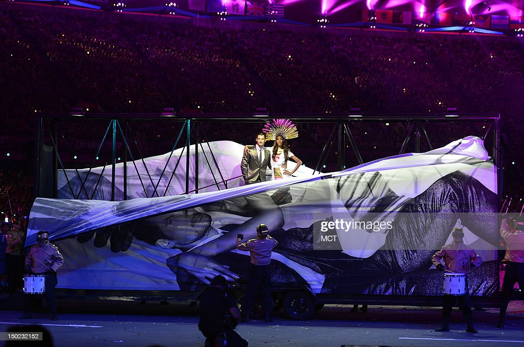 The front of a supermodels billboard on wheel drop to reveal live models, during the playing of David Bowie's 'Fashion,' at the Olympic Stadium in London, England, during the Closing Ceremony for the London 2012 Summer Olympic Games, Sunday, August 12, 2012.