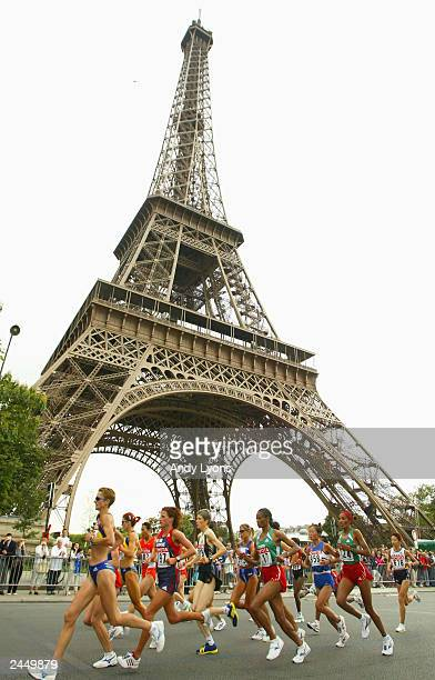 The front of the pack runs past the Eiffel Tower during the women's marathon at the 9th IAAF World Athletics Championship at the Stade de France on...