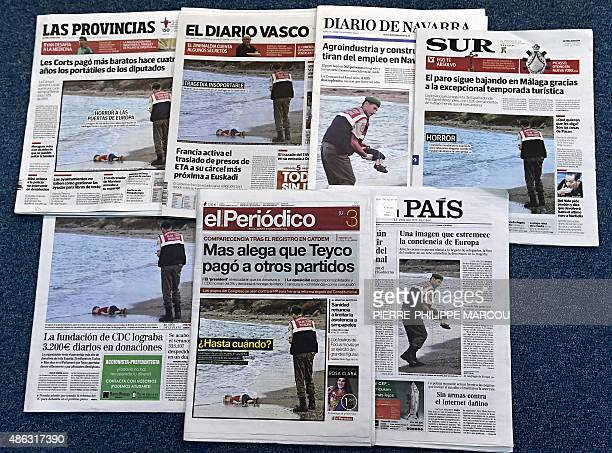 The front page of some Spanish newspapers showing the body of Syrian threeyearsold boy Aylan are pictured in Madrid on September 3 2015 The image...