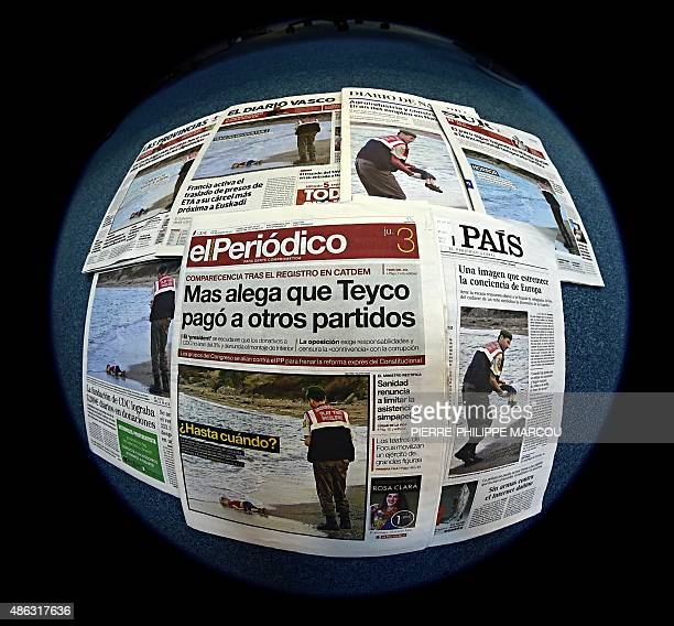 The front page of some Spanish newspapers showing the body of Syrian threeyearsold boy Aylan are pictured with a fisheye lens in Madrid on September...