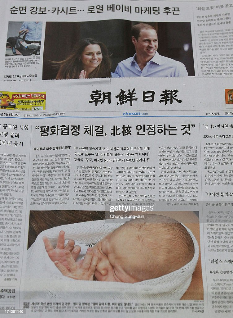The front page of the Chosun daily is displayed announcing 'The Birth Of The Duke And Duchess Of Cambridge's New Son' on July 25, 2013 in Seoul, South Korea. The Duchess of Cambridge gave birth to a boy on July 22 at 16.24 BST and weighing 8 lb 6oz, with Prince William at her side.
