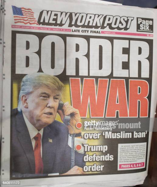 The front page of the New York Post shows a picture of President Donald Trump with a headline of 'Border War' following nationwide protests against...
