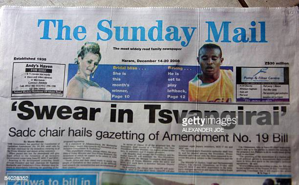 The front page of Zimbabwe local governmenet owned newspaper the Sunday Mail is displayed in Harare on December 14 2008 A draft constitutional...